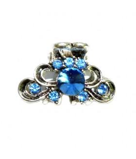 Крабик для волос серебристого цвета с голубыми стразами