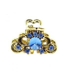 Крабик для волос золотого цвета с голубыми стразами