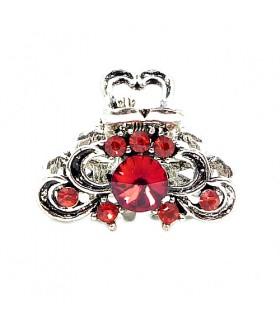 Крабик металлический серебристого цвета с красными стразами